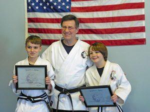 Yoshitsune Jujitsu Junior 1st Degree Black Belt Kyan and 2nd Degree Black Belt Josiah