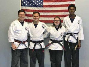 Goju ryu Karate Adult 2nd Degree Black Belt Brendan, Adult 1st Degree Black Belt Degree Maggie, and Junior 1st Degree Black Belt Ethan